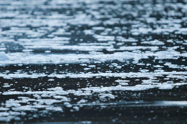 Foam pattern on beach