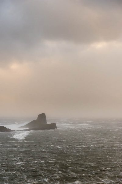 A hint of sunset colours over Worm's Head,Rhossili Bay, Gower Peninsula